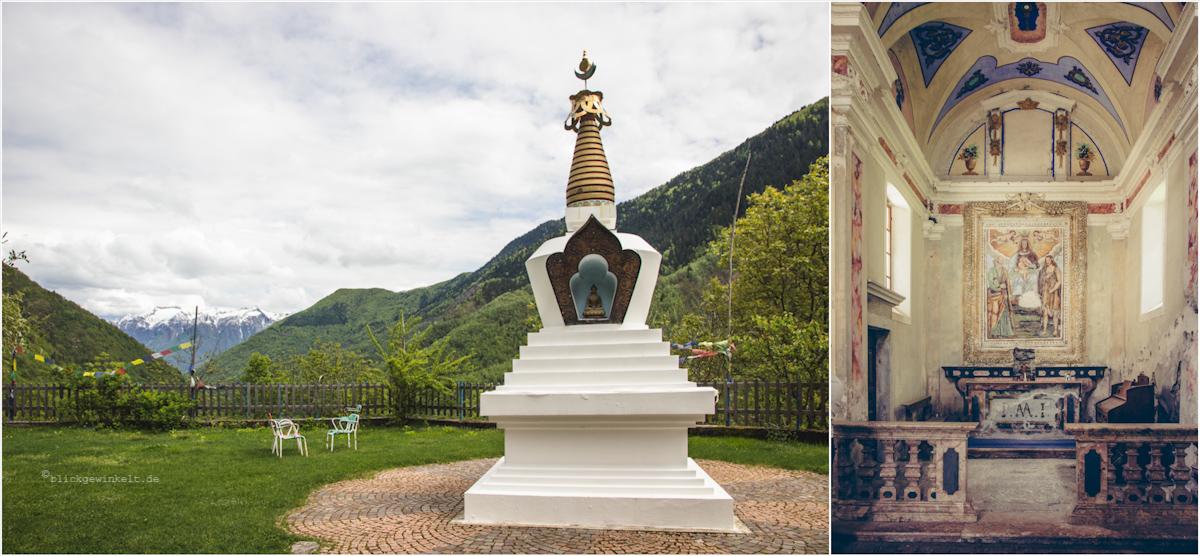 Stupa mit Bergen im Hintergrund; Kirche