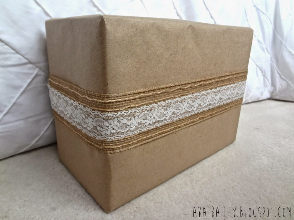 Brown paper gift wrap wrapped with burlap ribbon and lace