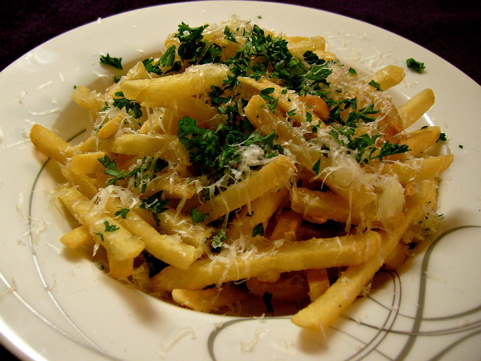 ... ' Kitchen: Pommes Frites with Truffle Oil, Parmesan, and Parsley