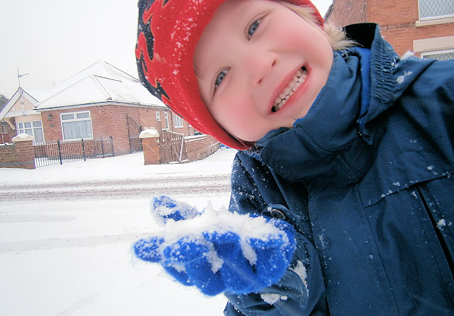 boy making snowballs