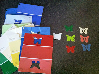 Use old paint chips and a butterfly punch to create colorful artwork | A Crafty Wife