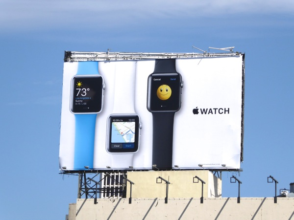 Apple Watch smiley emoji billboard