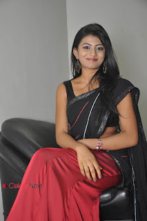 Haasika Picture Gallery in Black Saree at Prema Katha Chitram Audio Release Function  0025.jpg