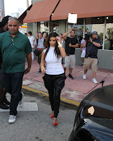 Kim Kardashian with a bodyguard