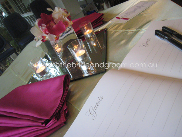 Our Fuschia Taffeta Napkins with the Mint Green Satin tablecloth our