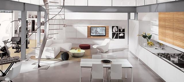 Cuisine design blanche et bois entièrement ouverte sur le salon blanc épuré. Une touche de bois équilibre parfaitement le côté froid du blanc épuré. L'ensemble est associé à du mobilier design.