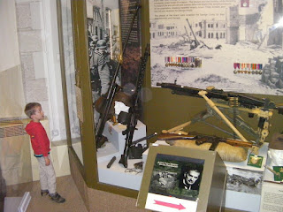 cabinet of firearms in museum