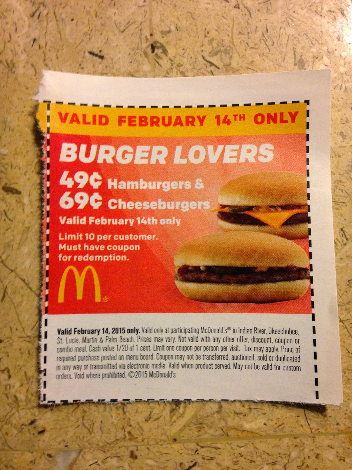 """Valid February 14th only"" ""BURGER LOVERS"" ""49¢ Hamburgers & 69¢ Cheeseburgers"" ""Valid February 14th only"" ""Limit 10 per customer."" ""Must have coupon for redemption."""