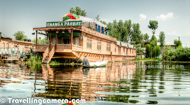 Dal Lake is one of the most popular lakes of India, which is located in Srinagar, the summer capital of Jammu and Kashmir. The urban lake, which is the second largest in the state, is integral to tourism and recreation in Kashmir and is nicknamed the 'Jewel in the crown of Kashmir' or 'Srinagar's Jewel'. The lake is also an important source for commercial operations in fishing and water plant harvesting.The shore line of the lake is encompassed by a boulevard lined with Mughal era gardens, parks, houseboats and hotels. Scenic views of the lake can be witnessed from the shore line Mughal gardens, such as Shalimar Bagh and Nishat Bagh built during the reign of Mughal Emperor Jahangir) and from houseboats cruising along the lake in the colourful shikaras. Dal Lake has some Floating gardens as well. The floating gardens, known as 'Rad' in Kashmiri, blossom with lotus flowers during July and August. The wetland is divided by causeways into four basins - Gagribal, Lokut Dal, Bod Dal and Nagin (although Nagin is also considered as an independent lake). During our trip to Shrinagar, we stayed in a hotel around Nagin lake only. Oldest Five star of the city is located on the bank of Nagin Lake. Lokut-dal and Bod-dal each have an island in the centre, known as Rup Lank (or Char Chinari) and Sona Lank respectively.  There are some personal houses around Dal Lake and people have their own boats to travel from one place to another for getting stuff from Lake-Market, which is again located inside Dal Lake only. Houseboats and the Dal Lake are widely associated with Srinigar and are nicknamed 'floating palaces', built according to British customs.The houseboats are generally made from local cedar-wood and are graded in a similar fashion to hotels according to level of comfort.Many of them have lavishly furnished rooms, with verandas and a terrace to serve as a sun-deck or to serve evening cocktails.They are mainly moored along the western periphery of the lake, close to the lakeside boulevard in the vicinity of the Dal gate and on small islands in the lake. They are anchored individually, with interconnecting bridges providing access from one boat to the other.The kitchen-boat is annexed to the main houseboat, which also serves as residence of the boatkeeper and his family.Many boats on Dal Lake are used for selling stuff to tourists. Anything like Artificial Jewellery, Corns, Fruits, Cloths, Wooden Articles, Flowers etc. Some of the vendors can be seen selling digital-cards for still/video cameras.        Each houseboat has an exclusive shikara for ferrying guests to the shore. A shikara is small paddled taxi boat, often about 15 feet and made of wood with a canopy and a spade shaped bottom.It is the cultural symbol of Kashmir and is used not only for ferrying visitors but is also used for the vending of fruits, vegetables and flowers and for the fishing and harvesting of aquatic vegetation.All gardens in the lake periphery and houseboats anchored in the lake are approachable through shikaras.The boats are often navigated by two boatmen dressed in 'Phiron' (traditional dress) and carry 'Kangris' or portable heaters on the boat.A shikara can seat about six people and have heavily cushioned seats and backrests to provide comfort in Mughul style.All houseboat owners provide shikara transport to their house guests free of charge. The shikara is also used to provide for other sightseeing locations in the valley, notably a cruise along the Jhelum River, offering scenic views of the Pir Panjal mountains and passing through the famous seven bridges and the backwaters enroute.