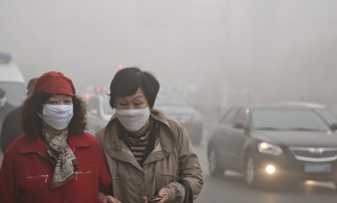 Quite literally sick and tired of the smog. (Credit: ChinaFotoPress/Getty Images) Click to enlarge.