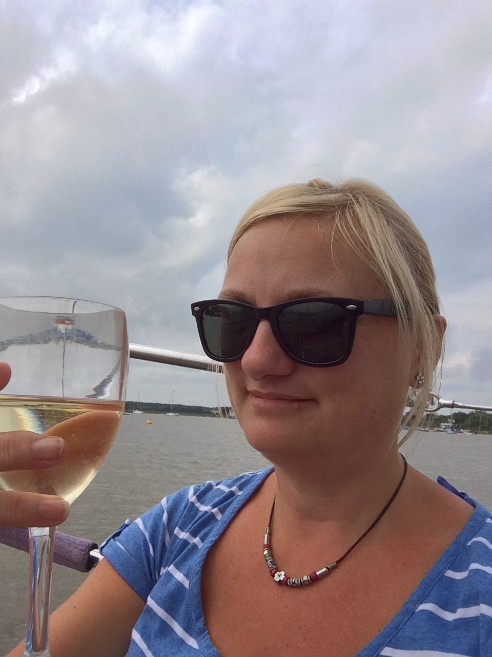 madmumof7 with wine on boat