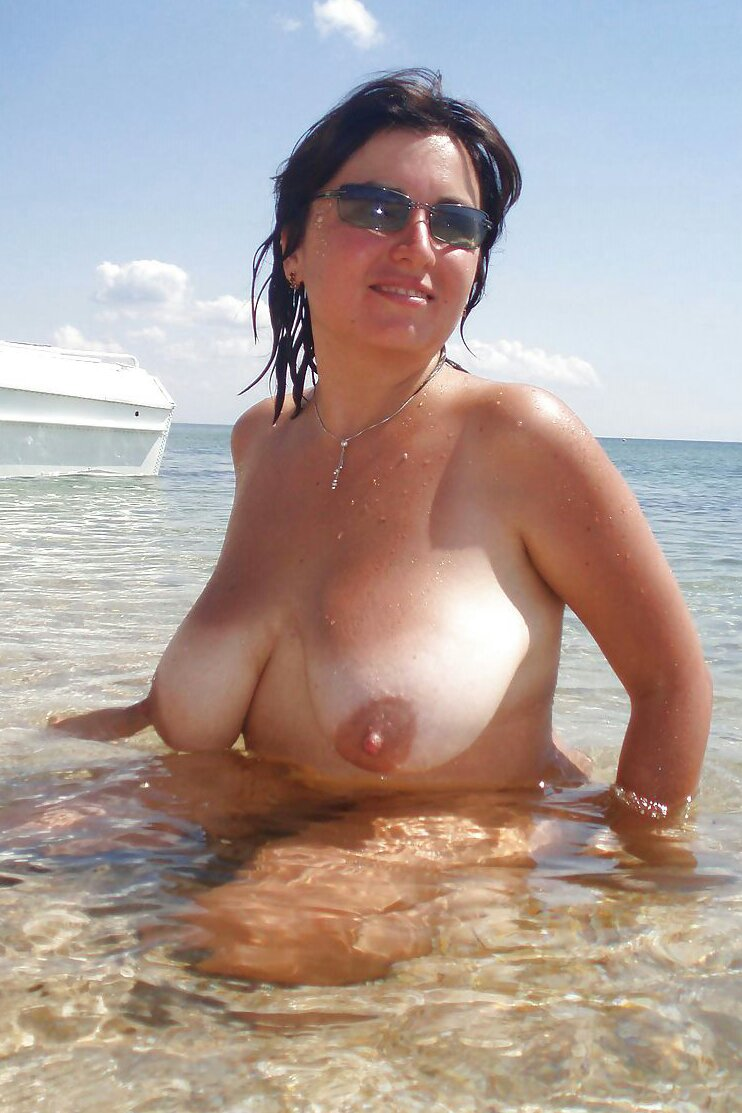 Busty milf at beach