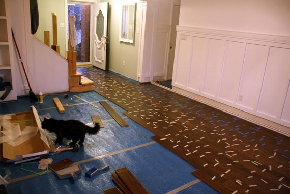 Can I tell you, I was about three weeks from having Lydia in this picture.  I sat this way for about 4 hours finishing up the floor cuz the next day  was ... - Remodelaholic Installing A Floating Wood Floor; Living Room