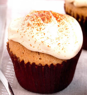 Italian-inspired cupcakes with a coffee sponge topped with mascarpone cheese frosting and a dusting of cocoa powder