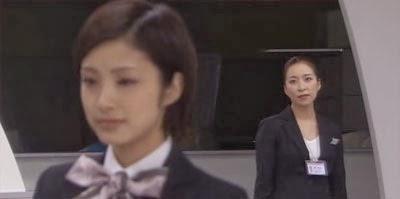 Misaki and Mikami in the model cabin.