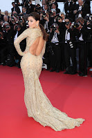 Eva Longoria shows off her hot gold dress at 2013 Cannes red carept