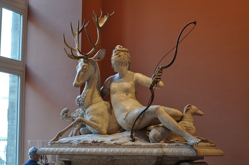 statue in museum of Diana reclining with a stag, holding a bow