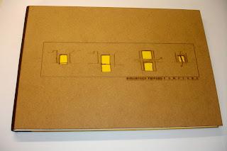 Encuadernacion con el lomo en piel marron y DM grabado con laser