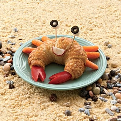 Family fun baby carrots form the legs and the claws are red bell