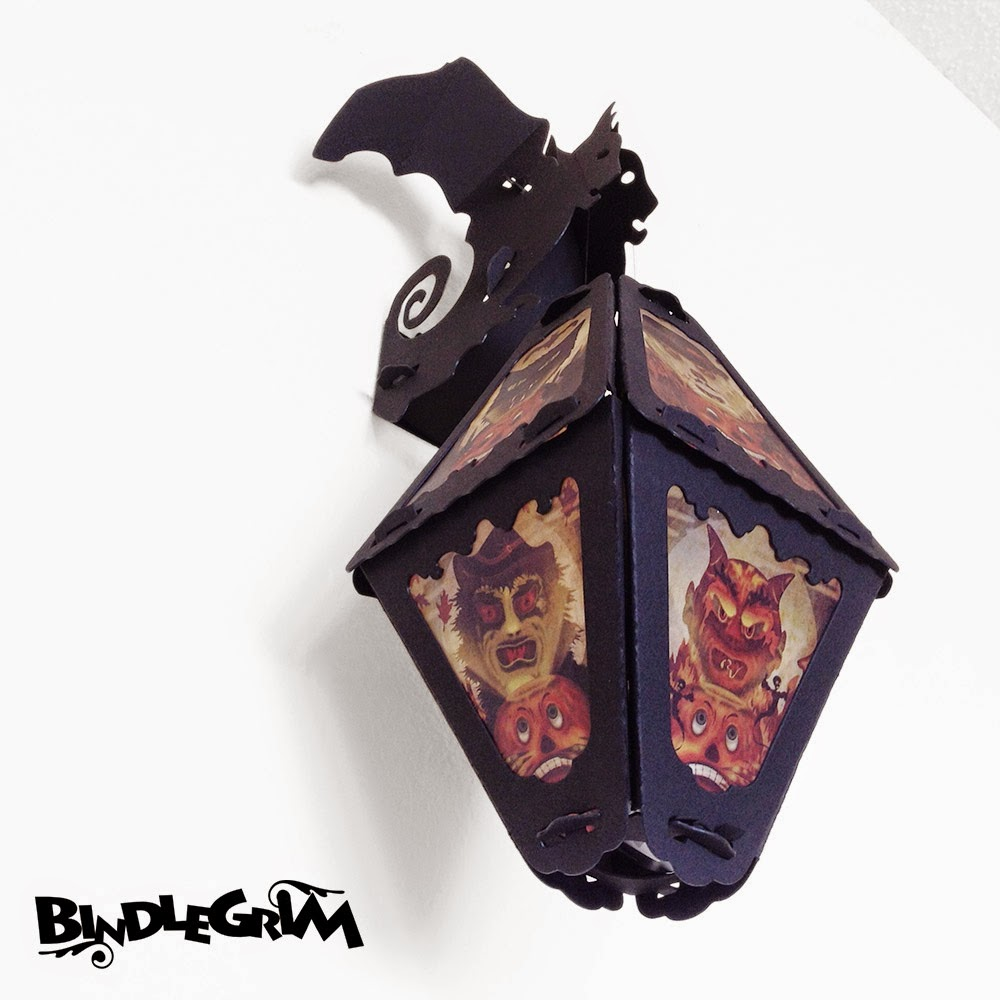 Vintage or vintage-style lanterns hang from the wall with this bat wall-hook decoration by Bindlegrim