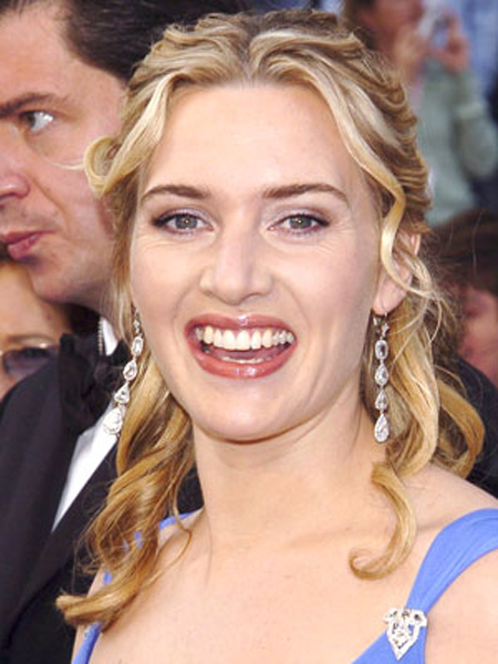 Sweetly defined coils add texture and movement through Kate Winslet's pinned back hairstyle.