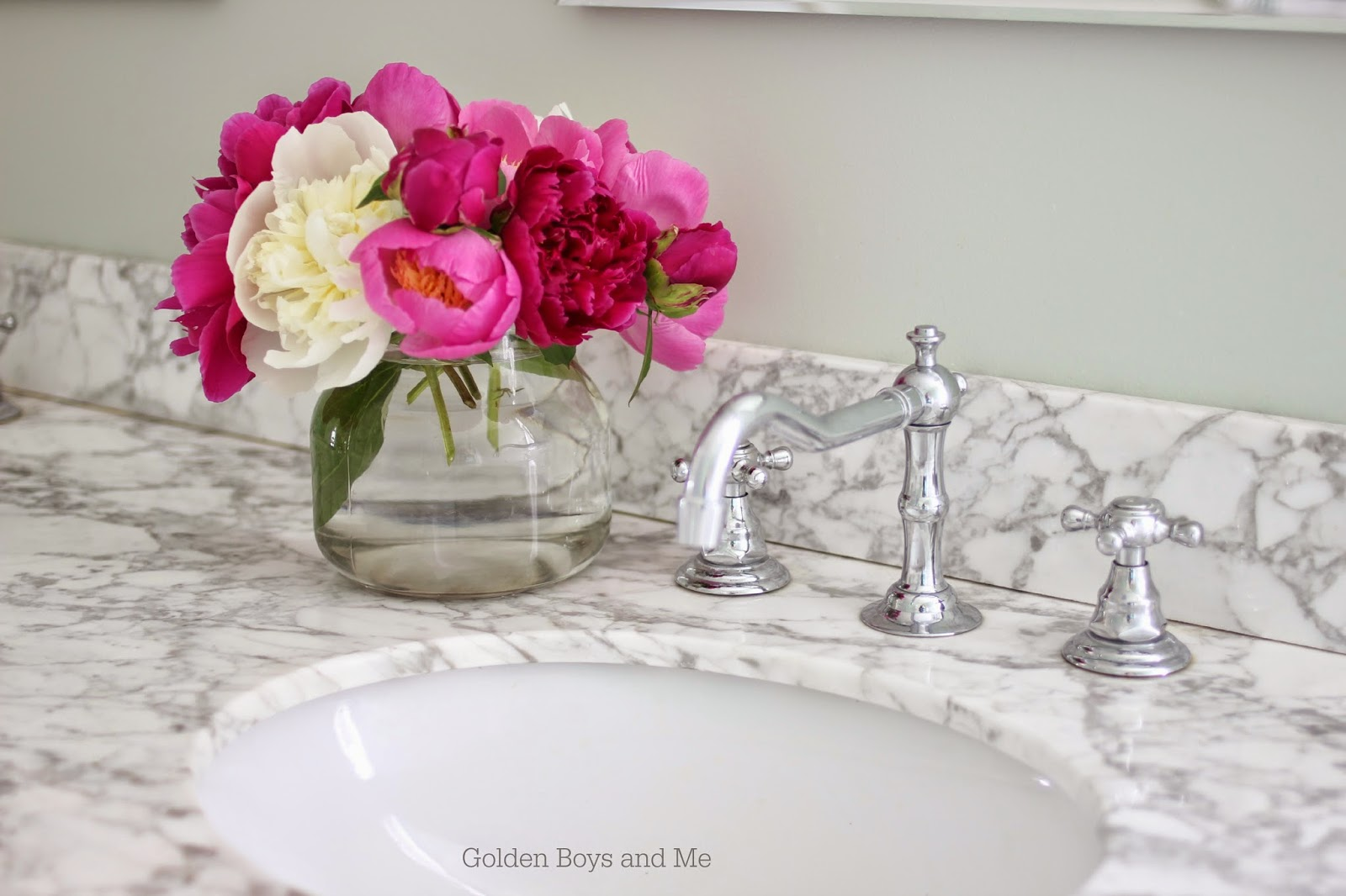 Pink and white peonies in master bath with carrera marble-www.goldenboysandme.com