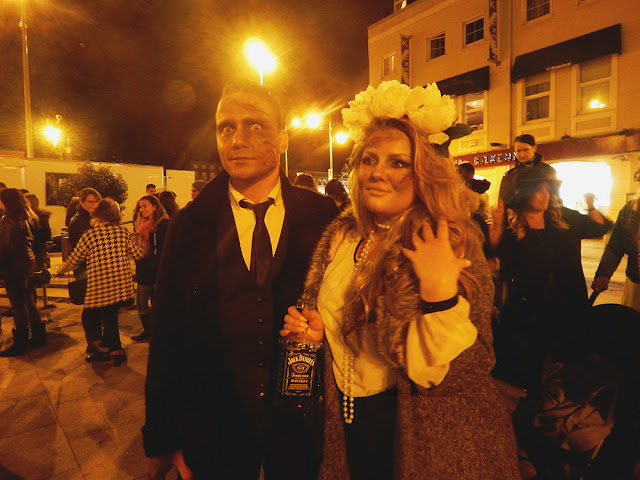 Two people dressed as zombies