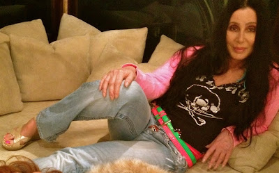Cher lies back during a photograph on the girls' night in