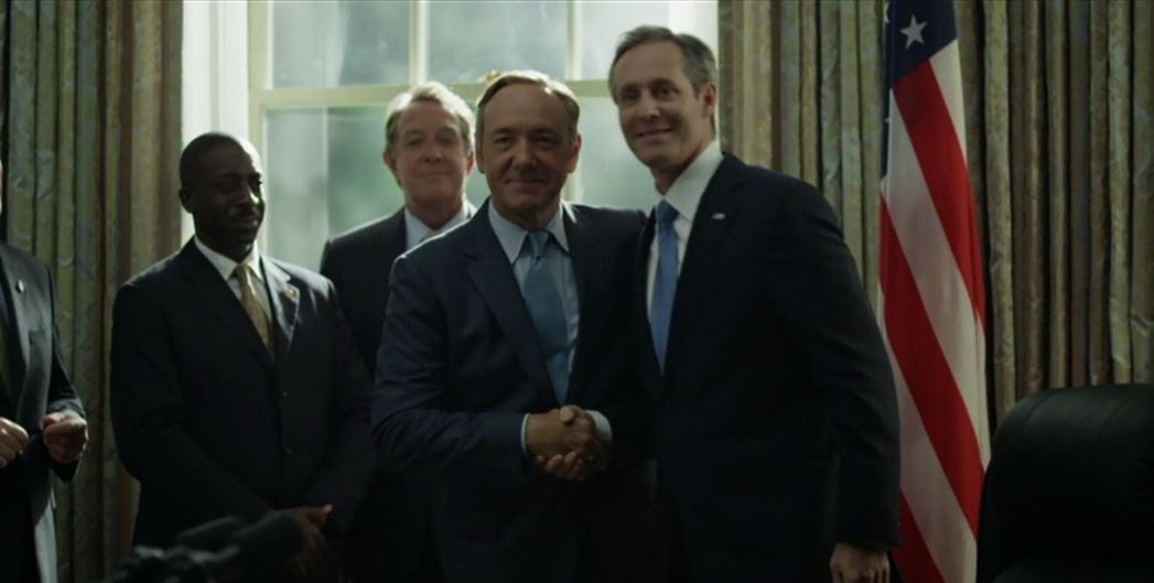 President Garret Walker signs Education Reform Bill congratulates Frank Underwood