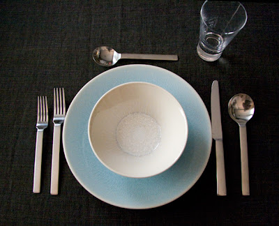 A simple, clean place setting with dark background