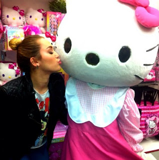 Miley Cyrus (Hannah Montana) kissing Hello Kitty
