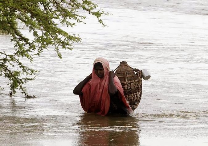 Somali saller milk woman in water