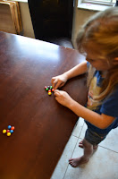 a pre kindergarten child designing with candies after counting to ten