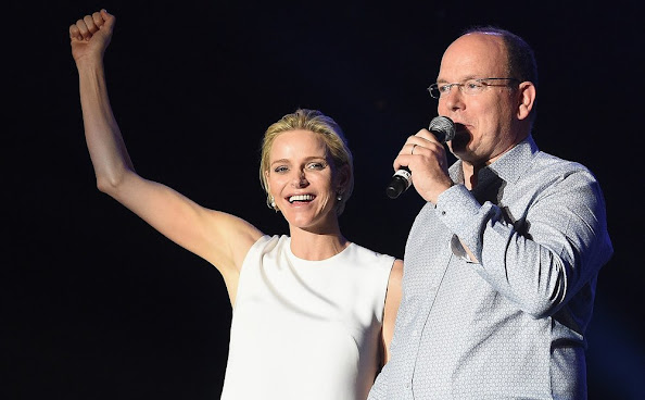 Princess Charlene of Monaco and Prince Albert II of Monaco attend the show of British singer Robbie Williams during celebrations marking Prince Albert II's decade on the throne