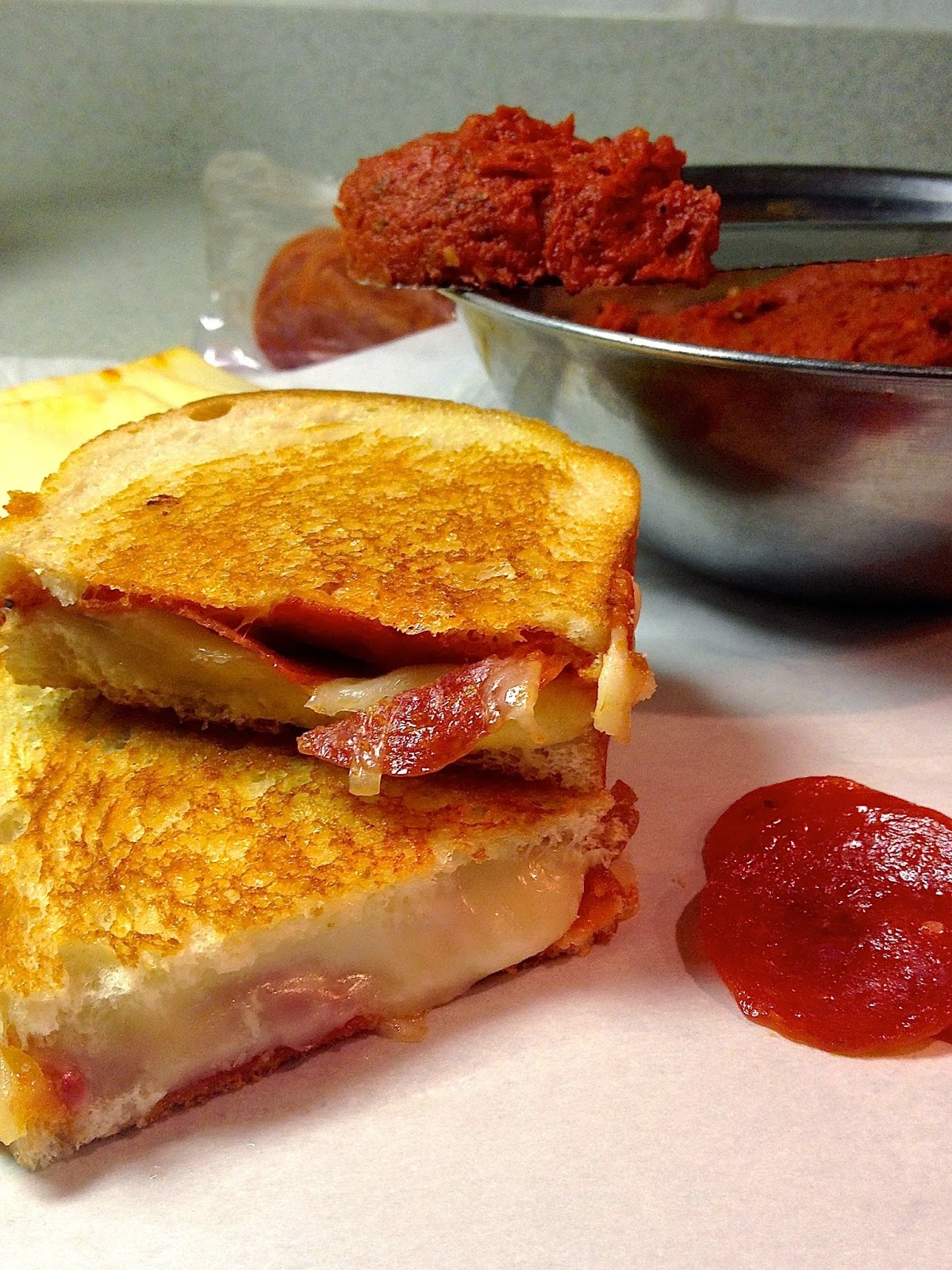 Pepperoni Pizza Grilled Cheese with Pizza Butter - www.soliloquyoffood.com