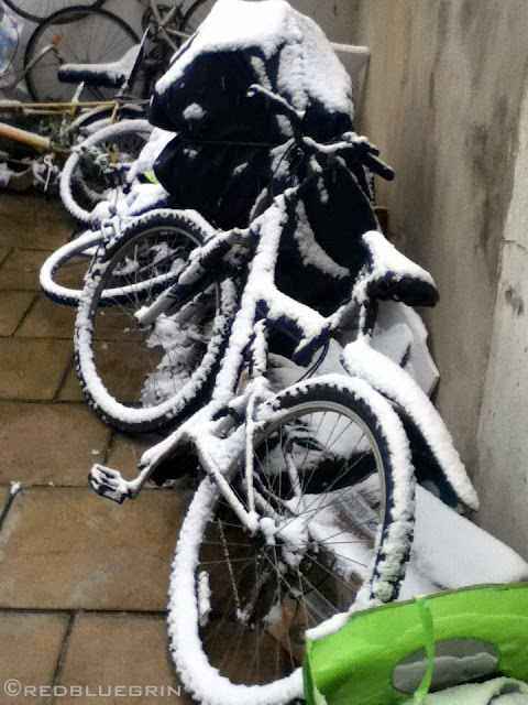 A cycle full of snow during winter at Brighton, UK