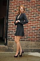 Emma Stone in a nice short dress showing some leg and high heels