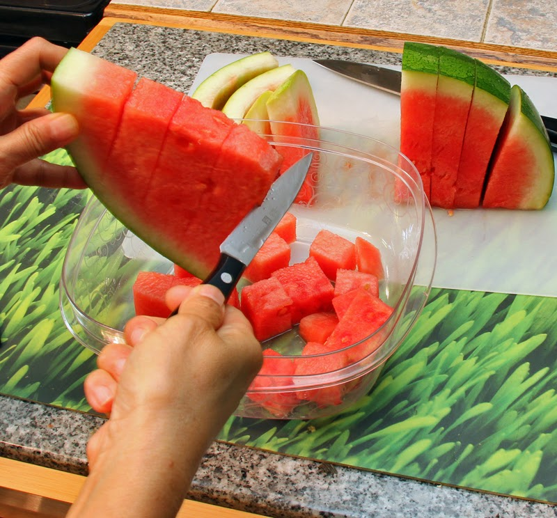 Slice watermelons into chunks