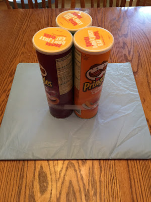 Add three pringles cans
