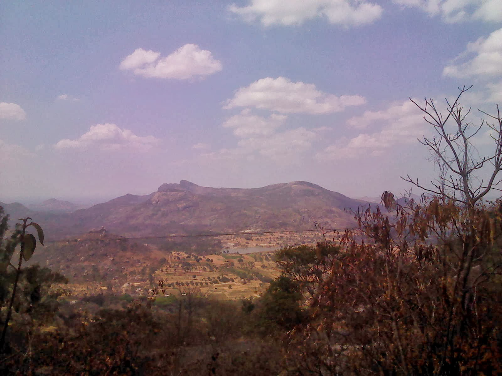 Photo of view from the climb towards Devarayanadurga showing lake