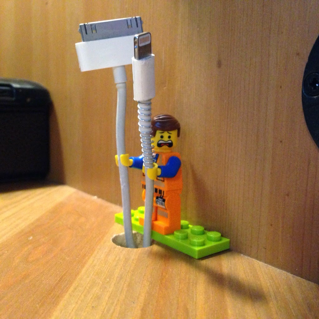 Lego minifig as cable holder every cord is awesome Charger cord organizer diy