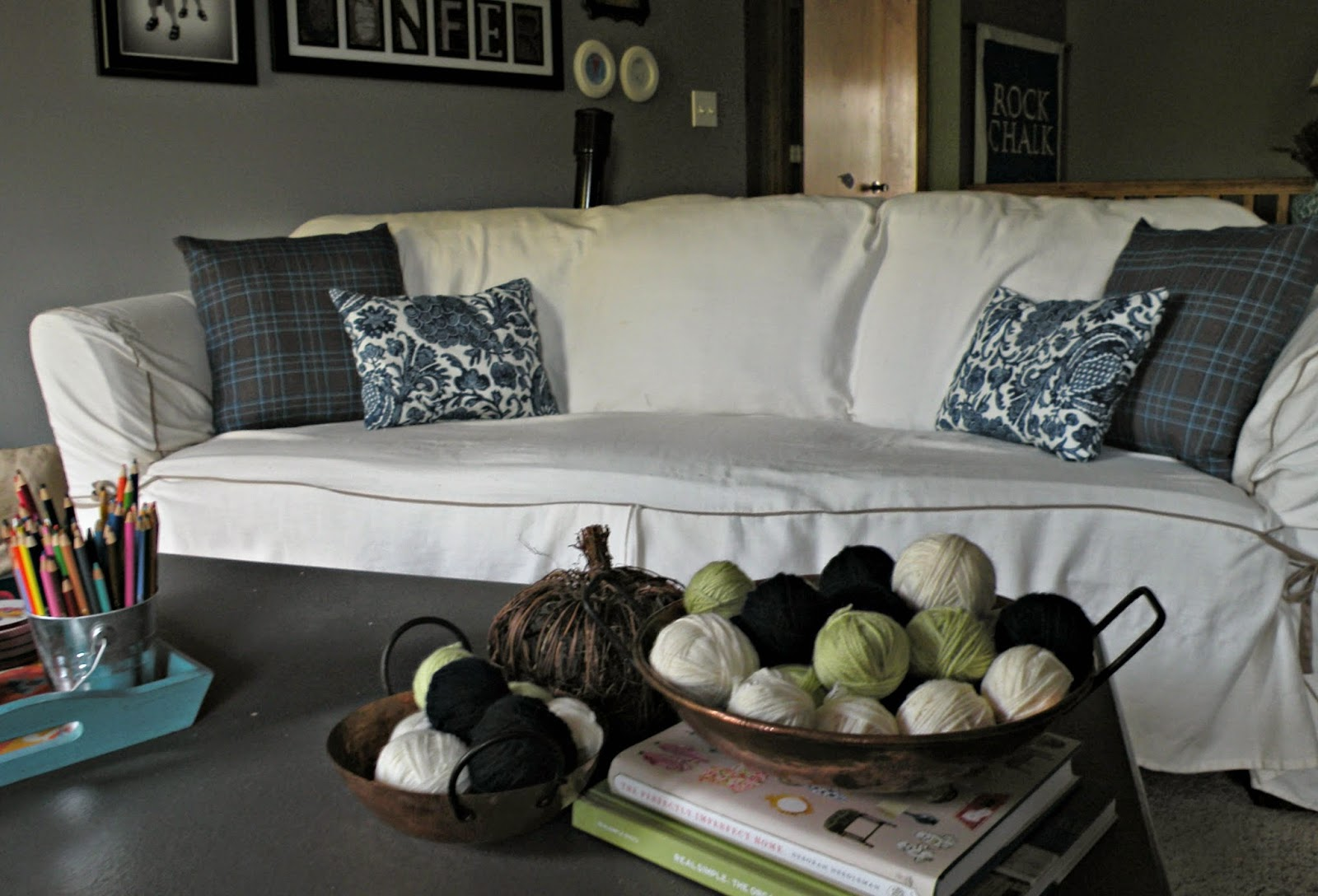 Navy blue mixed pattern pillows on white couch