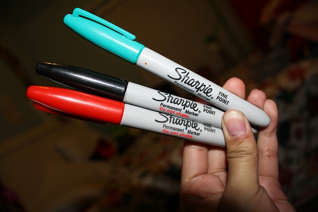 3 Sharpies in hand