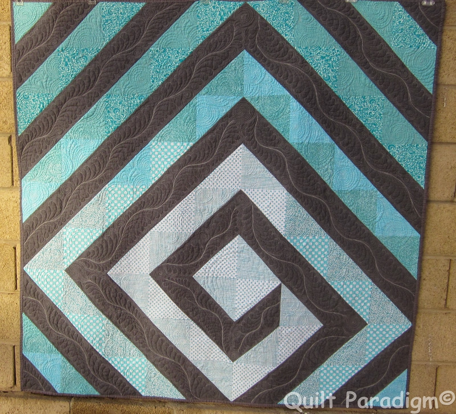 http://quiltparadigm.blogspot.com/2014/12/twirling-aqua-finished.html