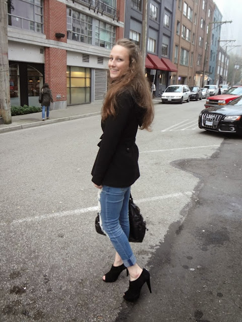 Alley in Vancouver, ripped blue jeans, black jacket, black purse, black heels