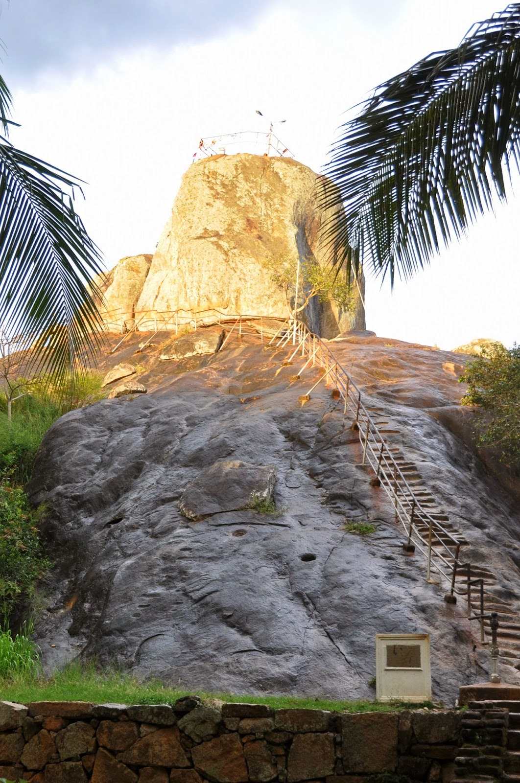 carved into granite rock steps lead to top Mihintale, ladders for pilgrims
