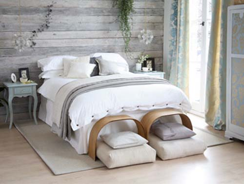 Beautiful A Rustic Bedroom In Shades Of Grey Is Chic And Sophisticated With Its Plush  Bedding, Wood Slated Walls And Floral Window Treatments.