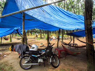 Motorcycle next to tarps at a coconut farm outside of Ho Chi Minh City