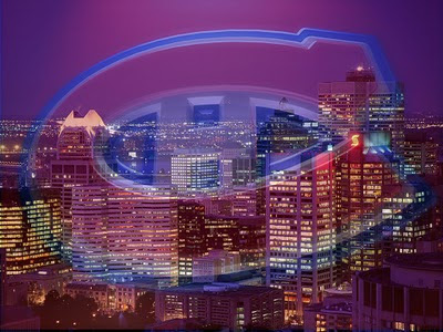Photo of Montreal with a large Habs logo superimposed over the city