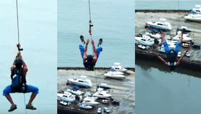 This guy gets tried of the longest zip line
